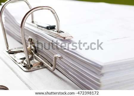 Selective focus.Close up of a business file folder with documents, storage of contracts.