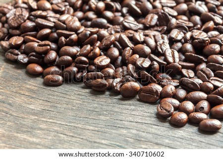 selective focus coffee bean on wood background. - stock photo