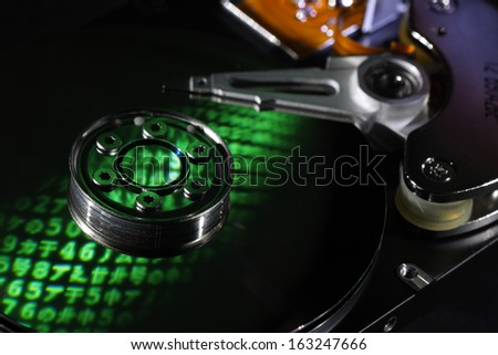 Selective focus encrypted hard disk with reflected letters - stock photo