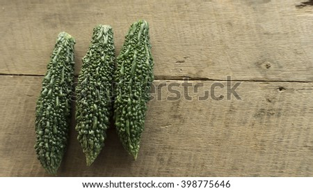 selective focus fresh bitter gourd on wood background - stock photo