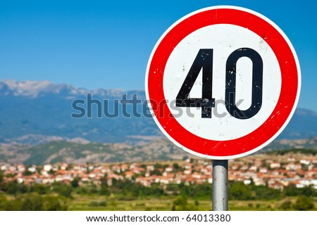 Selective focus image of an old speed limit road sign in rural Bulgaria.