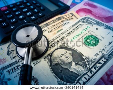 selective focus image of financial report, money and others. - stock photo