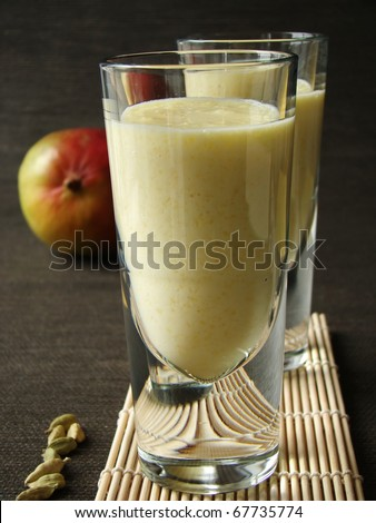 Selective focus image of Mang Lassi, a typical Indian drink with yoghurt. - stock photo