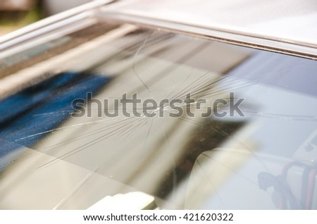 Selective focus image on Broken car windshield. Accident of car. - stock photo