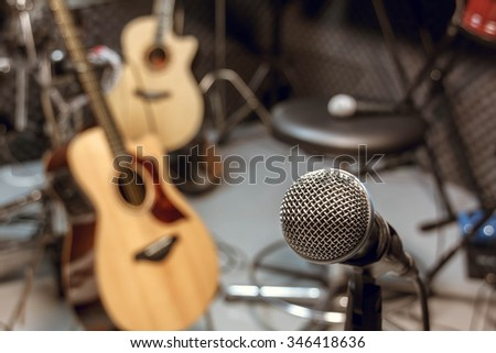selective focus microphone and blur musical equipment guitar,bass,drum background. - stock photo