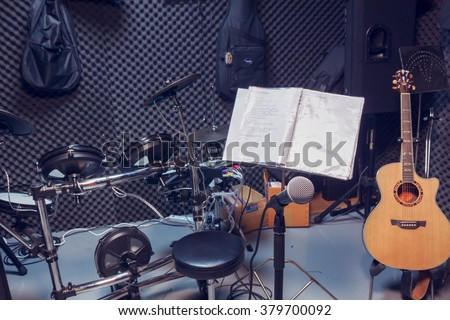 selective focus microphone and blur musical equipment guitar ,lyric, drum piano background. - stock photo