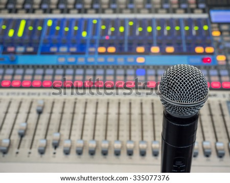 selective focus microphone on the blur sound mixer background.