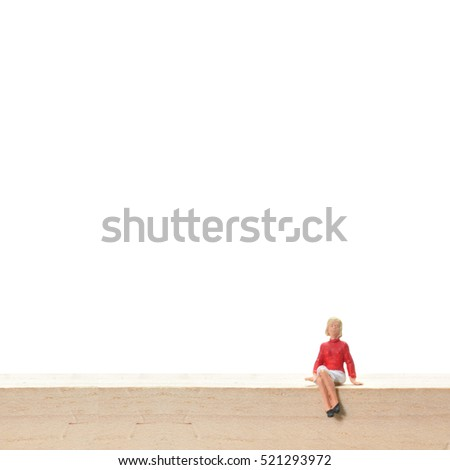 Selective focus, miniature people sitting on wooden block, business concept.