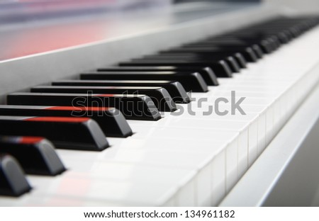 Selective focus of a piano keyboard - stock photo
