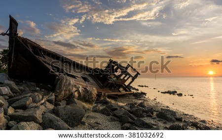 Selective focus of abandoned boat during magical sunset.Soft focus due to long exposure shot. Nature composition.Noise and grain due to long exposure shot - stock photo