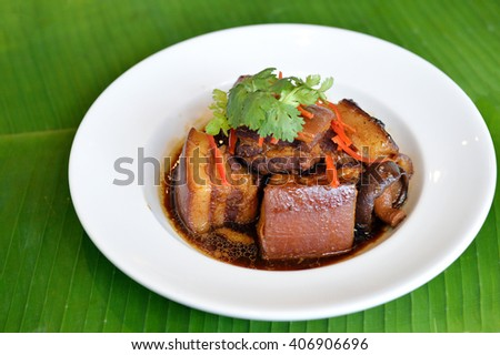Selective focus of braised pork in a sweet soy sauce - stock photo