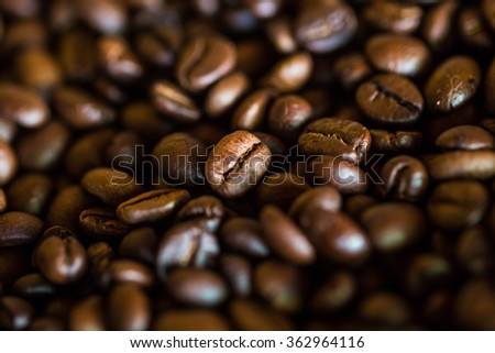 Selective focus of brown roasted coffee bean, Dept of field close up techniq - stock photo