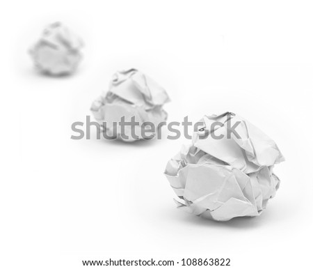 Selective focus of close-up of crumpled paper ball with white background. - stock photo