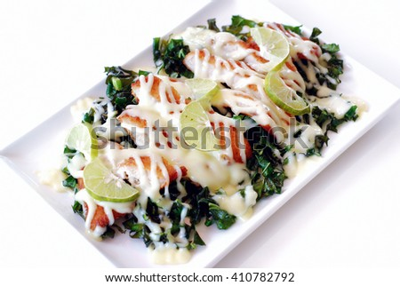 Selective focus of crispy fry chicken with lemon, mayonnaise and Chinese kale on white background