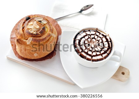 Selective focus of Latte coffee cup with cinnamon roll on white background - stock photo