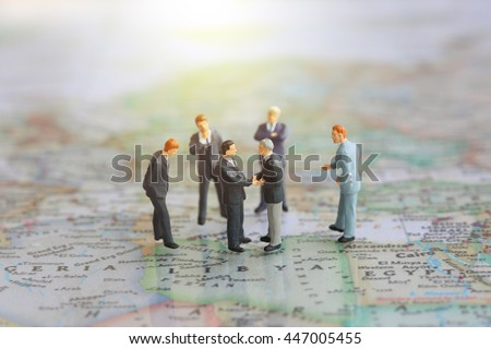 Selective focus miniature businessman handshake nigeria stock photo selective focus of miniature businessman handshake nigeria libya and egypt world map background as gumiabroncs Image collections