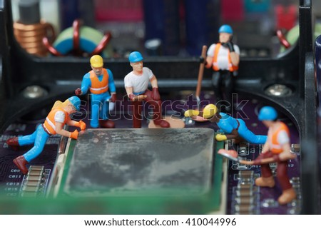 Selective focus of miniature engineer and worker fixed and repair CPU processor,  mainboard computer and use for business background. - stock photo