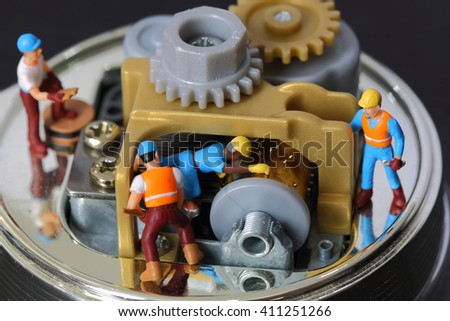 Selective focus of miniature engineer and worker fixed and repair musical box, use for product background. - stock photo