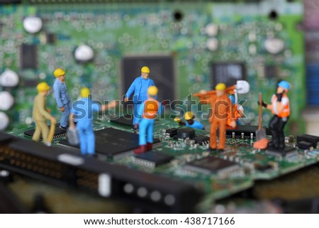 Selective focus of miniature engineer and worker fixed problem chipset of Personal computer (PC) on blurred mainboard background as business and industrial concept. - stock photo