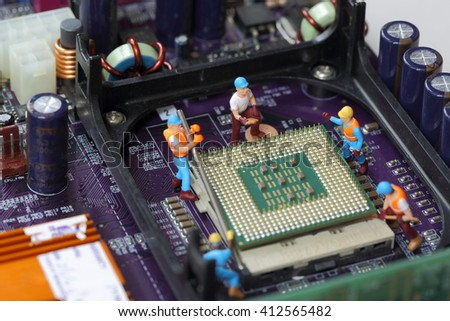 Selective focus of miniature engineer worker to fixed and repair CPU processor,  mainboard computer and use for industry background. - stock photo