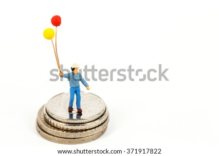 selective focus of miniature man hold balloon in his hand standing on euro coins isolated on white background, abstract background to money and saving concept. - stock photo
