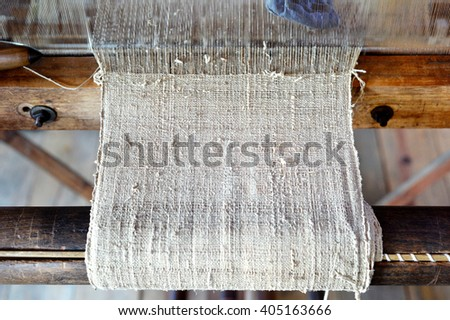 Selective focus of traditional hand weaving loom machine part - stock photo