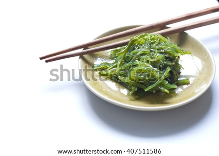selective focus of Wakame in a small dish with chopsticks, sea vegetable, or edible seaweed,subtly sweet flavour, farmers have grown wakame in Japan - stock photo