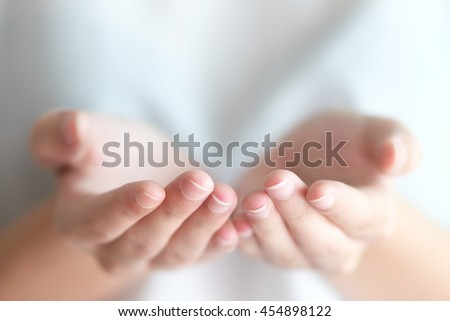 selective focus on a finger of woman open hand that are sign of give,charity,beg,carry with blurred background  - stock photo