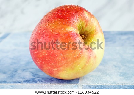 Selective focus on an organic ripe red apple. - stock photo