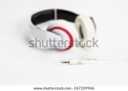 selective focus on audio plug of headphones on white background