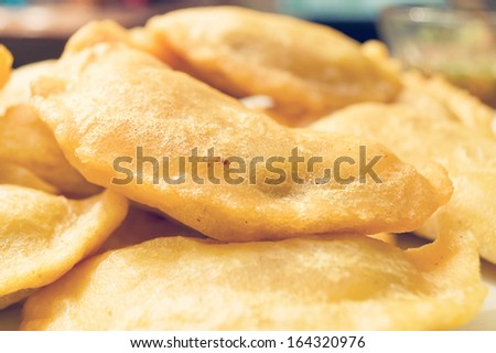 Selective focus on crispy Latin American Empanadas. - stock photo