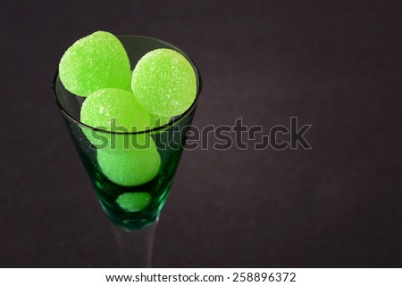Selective focus on green gum drops in a glass./Jelly Candies - stock photo