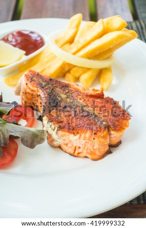 Selective focus on Salmon steak on white plate