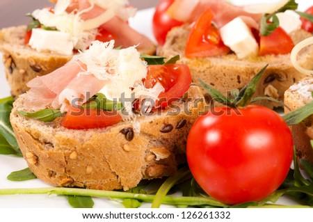 Selective focus on the bruschetta sandwich - stock photo