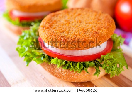 Selective focus on the fish burger on top of sandwich  - stock photo