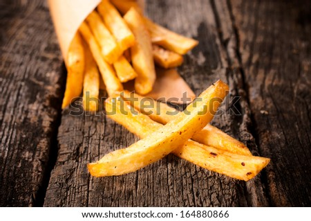 Selective focus on the front french fries on table - stock photo