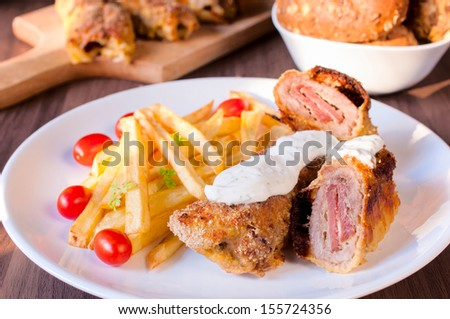 Selective focus on the front meat stuffed with prosciutto and cheese - stock photo