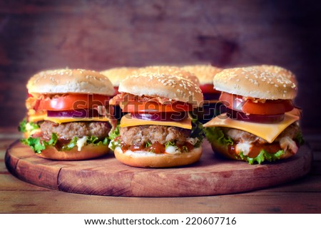 Selective focus on the front mini beef burger on wooden background