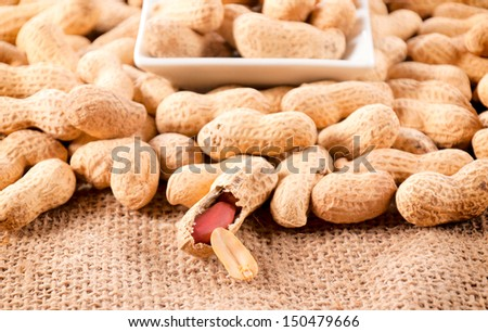 Selective focus on the front raw peanut in shell - stock photo