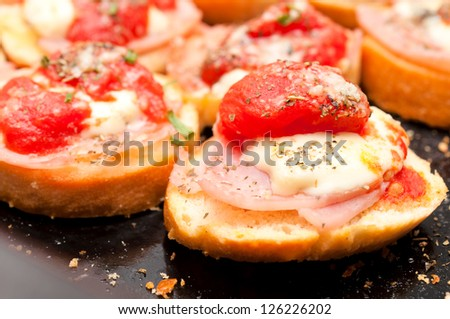 Selective focus on the right side bruschetta - stock photo