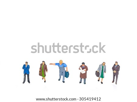 selective focus photo of miniature standing on white background. - stock photo