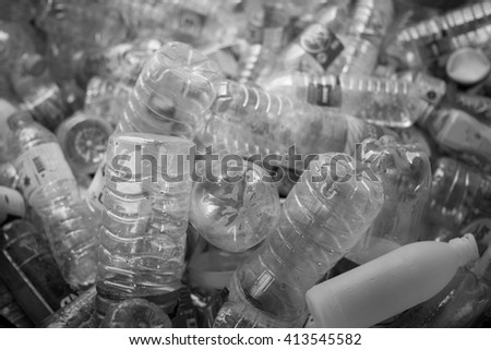 Selective focus plastic bottle black and white field,Recyclable waste concept. - stock photo