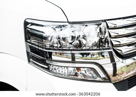 Selective focus point on Headlight lamp car - stock photo