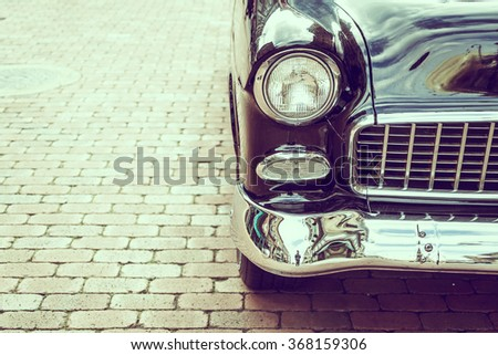 Selective focus point on Headlight lamp car - vintage filter