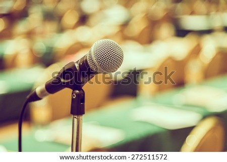 Selective focus point on Microphone in meeting room - vintage effect style pictures - stock photo