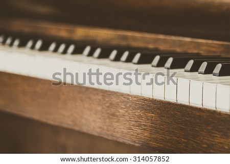Selective focus point on Old vintage piano keys - vintage filter effect - stock photo