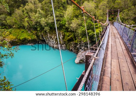 selective focus shot at the incredibly blue-colored hokitika gorge on the southern island of new zealand - stock photo