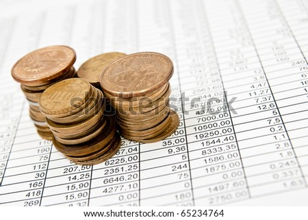 Selective focus shot of money on pages with financial numbers
