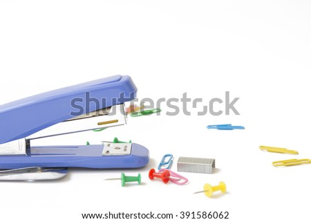 selective focus stapler and color full clips with note book on white background - stock photo