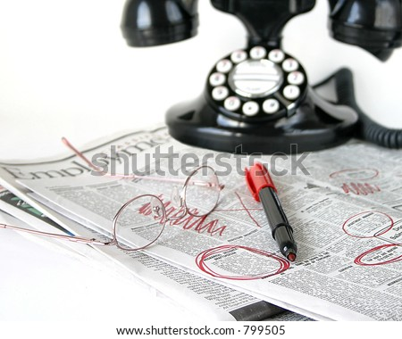 Selective focus used to draw eye to marker and circled ad. - stock photo